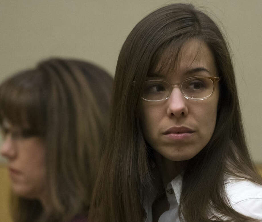 FILE - In this April 18, 2013 file photo, Jodi Arias stands during her trial at Maricopa County Superior Court in Phoenix. Arias faces a potential death sentence if convicted of first-degree murder in Travis Alexander's June 2008 killing at his suburban Phoenix home. Closing arguments in Arias' trial will be Thursday, May 2 and Friday, May 3, after which jurors will begin deciding her fate. (AP Photo/The Arizona Republic, Mark Henle, Pool, File)