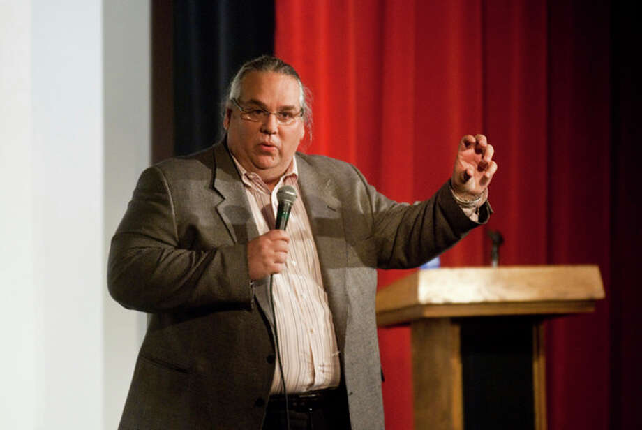 In this March 3, 2010 photo, the Rev. Carl Keyes speaks to an audience in Harrisonburg, Va., about his life experiences relating to his organization, Aid for the World. Before the Sept. 11, 2001 attacks, Keyes was a little-known pastor of a small New York City congregation searching for members and money. When the twin towers fell, his fortunes changed. Donors poured $2.5 million into the minister's charity to help 9/11 victims. More opportunities to raise relief money would come later, with at least another $2.3 million collected for efforts along the hurricane-ravaged Gulf Coast, in the poorest corners of West Virginia and Tennessee, and even in remote African villages. Tens of millions more flowed through his fingers from the sale of church properties. But Keyes, a one-time construction worker, did more than help the needy with the millions donated - he helped himself. According to financial records, internal correspondence and interviews with former employees conducted by The Associated Press, Keyes blurred the lines between his charities, his ministry and his personal finances while promoting himself as an international humanitarian. (AP Photo/Ryan Freeland) / AP