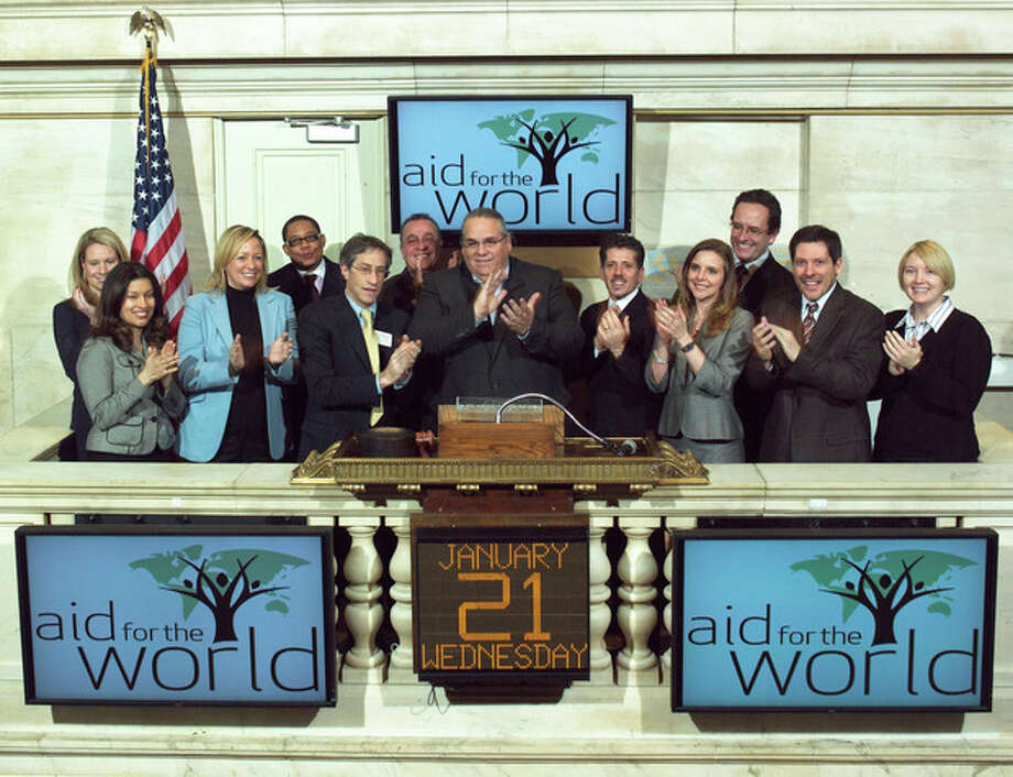 In this Jan. 21, 2009 photo provided by the New York Stock Exchange, the Rev. Carl Keyes, founder of Aid for the World, rings the opening bell at the New York Stock Exchange. Keyes ran Aid for the World, which boasted of operating anti-poverty programs in the U.S. and on several continents, for more than three years without disclosing its finances as required. (AP Photo/NYSE) / New York Stock Exchange