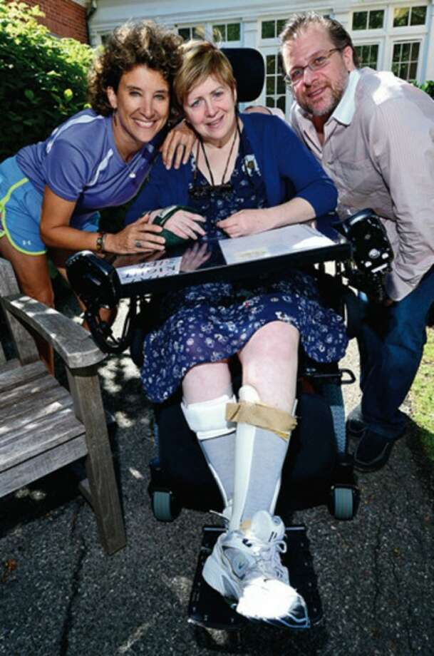 Hour photo / Erik TrautmannStacy Mehok, who was a cheerleader in the '70s for Westhill, was hurt very badly in a car crash and has been in a wheelchair since.
