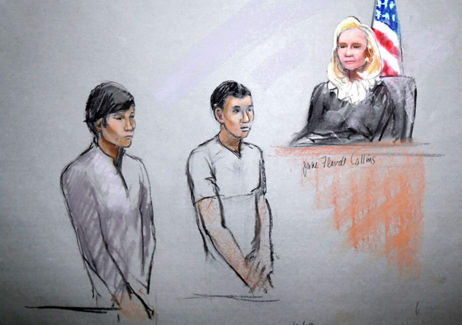 This courtroom sketch shows defendants Dias Kadyrbayev, left, and Azamat Tazhayakov appearing in front of Federal Magistrate Marianne Bowler at the Moakley Federal Courthouse in Boston on Wednesday, May 1, 2013. The two college friends of Boston Marathon bombing suspect Dzhokhar Tsarnaev, and another man, were arrested and charged with removing a backpack containing hollowed-out fireworks from Tsarnaev's dorm room. (AP Photo/Jane Flavell Collins) / AP