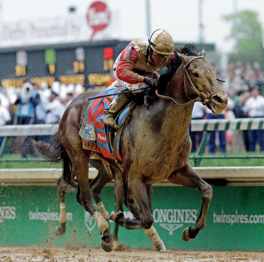 Joel Rosario rides Orb during the 139th Kentucky Derby at Churchill Downs Saturday, May 4, 2013, in Louisville, Ky. (AP Photo/J. David Ake) / AP