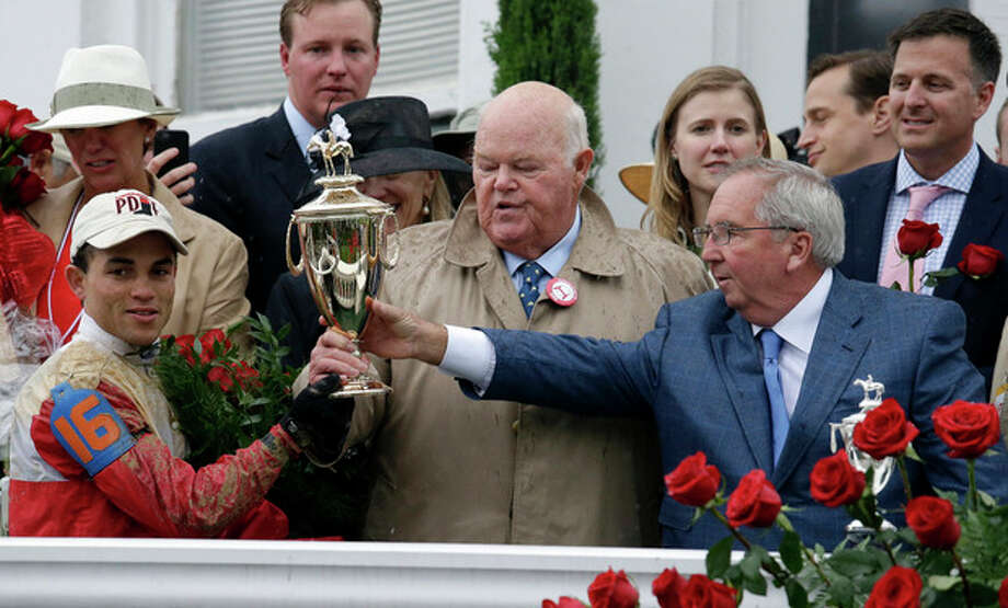 Orb jockey Joel Rosario, left, trainer Claude McGaughey, right, and owner Ogden Phipps celebrate after winning the 139th Kentucky Derby at Churchill Downs Saturday, May 4, 2013, in Louisville, Ky. (AP Photo/J. David Ake) / AP
