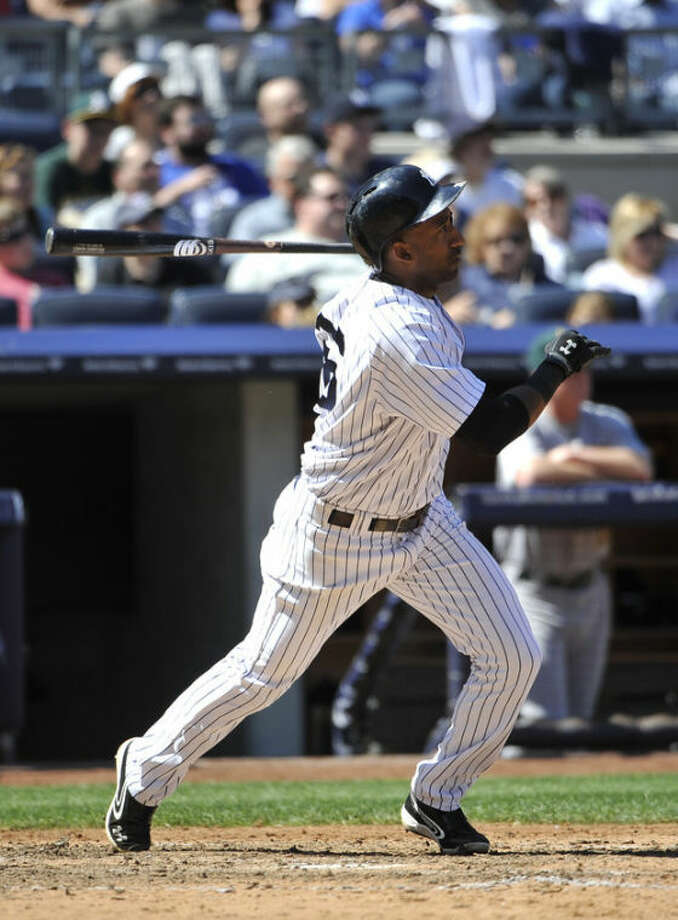 New York Yankees' Eduardo Nunez hits a triple off of Oakland Athletics relief pitcher Chris Resop in the seventh inning of a baseball game at Yankee Stadium on Saturday, May 4, 2013 in New York. (AP Photo/Kathy Kmonicek)