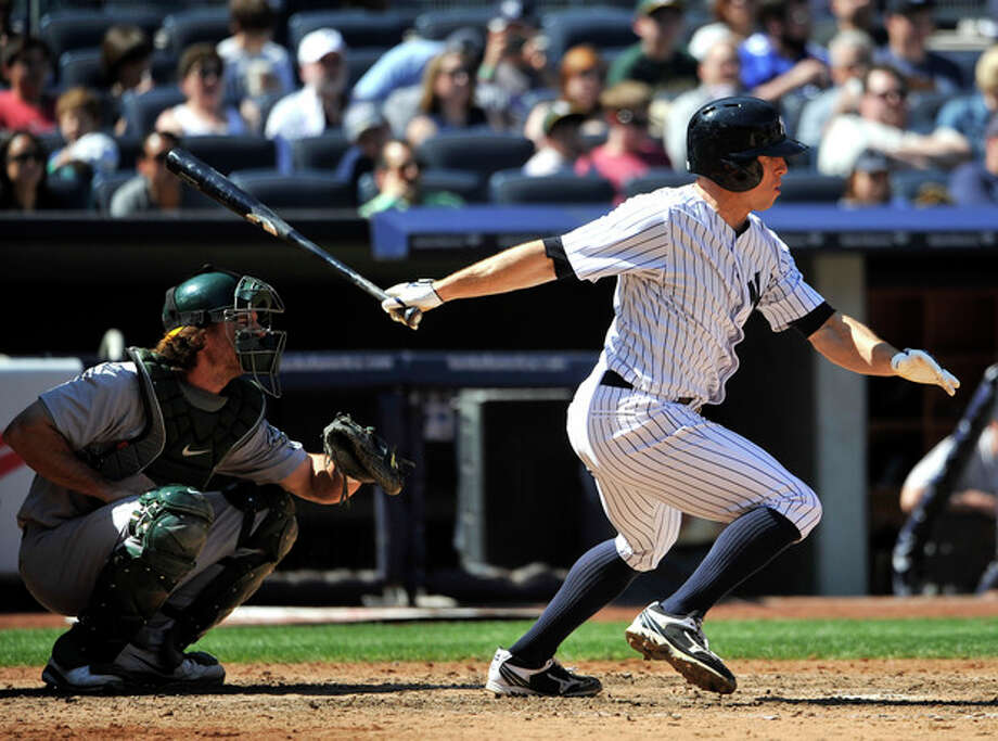 New York Yankees' Brett Gardner hits an RBI single off in Oakland Athletics relief pitcher Chris Resop in the seventh inning of a baseball game at Yankee Stadium on Saturday, May 4, 2013 in New York. (AP Photo/Kathy Kmonicek) / FR170189 AP