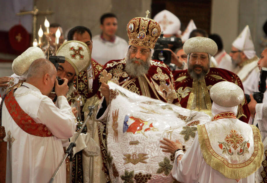 Pope Tawadros II, the 118th pope of the Coptic Church of Egypt, leads the Easter Mass at St. Mark's Cathedral in Cairo, Egypt, late Saturday May 4, 2013. Egypt's Coptic Christians, who make up about 10 percent of the country's 85 million people, have long complained of discrimination by the state. They are the largest Christian community in the Middle East. (AP Photo/Amr Nabil) / AP