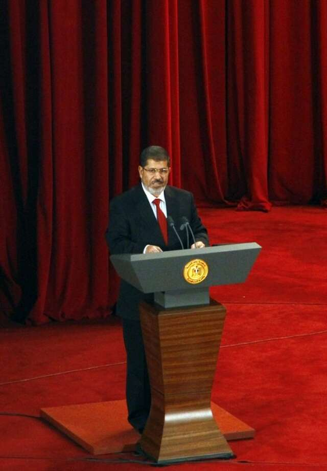 "FILE -- In this Saturday, June 30, 2012 file photo, Egypt's newly inaugurated President Mohammed Morsi speaks at Cairo University in Cairo, Egypt. On the eve of his first trip to the United States as Egypt's president, Mohammed Morsi has told the New York Times, in his first interview with an American publication, that he envisions the longtime strategic allies to be ""real"" friends but said Washington should not expect his country to live by its rules. (AP Photo/Ahmed Abdel Fattah, File)"