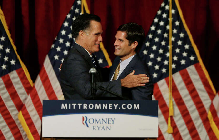 Republican presidential candidate and former Massachusetts Gov. Mitt Romney, left, is introduced by his son Matt before he speaks at a campaign fundraising event in Del Mar, Calif., Saturday, Sept. 22, 2012. (AP Photo/Charles Dharapak) / AP