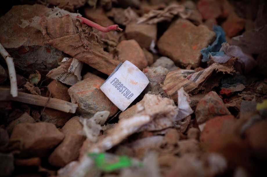A clothes tag lies in the rubble of a garments factory that collapsed in Savar near Dhaka, Bangladesh, Saturday, May 5, 2013. Officials said Saturday that more than 530 bodies have been pulled from the wreckage of the eight-story Rana Plaza building that collapsed last week, sparking desperate rescue efforts, a national outpouring of grief and violent street protests. (AP Photo/Ismail Ferdous) / AP