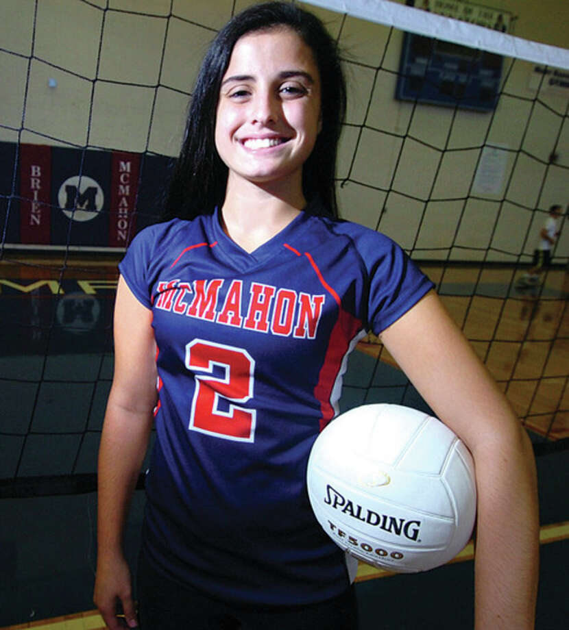 Hour Photo/ Alex von KleydorffCristina Castagna, a senior on the Brien McMahon volleyball team is the final member of her family to suit up for the Senators, capping an 11-year run in the program. / 2012 The Hour Newspapers