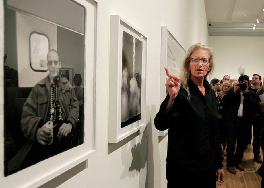 "Annie Leibovitz talks about some of her work during a tour of her exhibition at the Wexner Center for the Arts Friday, Sept. 21, 2012, in Columbus, Ohio. Leibovitz's exhibition features work from her ""Master Set,"" an authoritative edition of 156 images. (AP Photo/Jay LaPrete) / FR52593 AP"