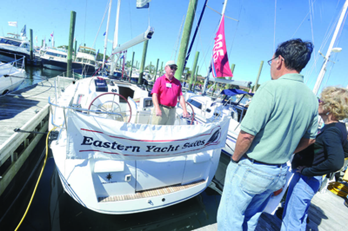 Ed Hellenbrecht, yacht sales and brokerage with Eastern Yacht Sales at Hellier pitches the Sun Odyssey Sunday at the boat show in Norwalk. hour photo/Matthew Vinci