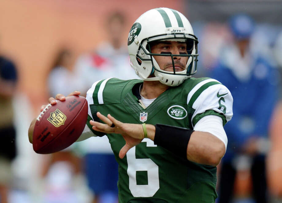 New York Jets quarterback Mark Sanchez (6) looks to pass during the first half of an NFL football game against the Miami Dolphins, Sunday, Sept. 23, 2012, in Miami. (AP Photo/Rhona Wise) / FR168022 AP