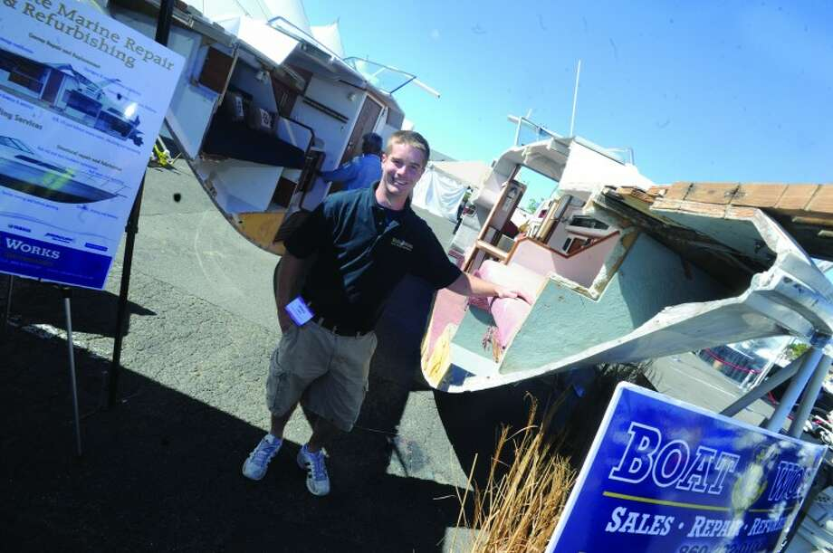 Tom Krivickas with Boat Works Sunday at the boat show in Norwalk. hour photo/Matthew Vinci