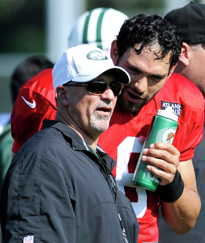 ADVANCE FOR WEEKEND OF EDITIONS OF SATURDAY, SEPT. 22 AND THEREAFTER - FILE - In this July 30, 2012, file photo, New York Jets quarterback Mark Sanchez, right, talks to offensive coordinator Tony Sparano, left, at NFL football training camp in Cortland, N.Y. Sparano, operating in the New York fishbowl, already has Jets fans grumbling after just two games as their offensive coordinator. Sparano and Miami Dolphins offensive coordinator Mike Sherman will match wits Sunday, Sept. 23, 2012, when the Dolphins face the Jets, with both teams at 1-1 and part of a four-way tie for the AFC East lead. (AP Photo/Bill Kostroun, File) / FR51951 AP