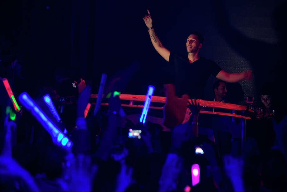 DJ Cedric Gervais performs for revelers at the Surrender nightclub in Las Vegas on Sunday, Jan. 20, 2013. (AP Photo/Julie Jacobson) / AP