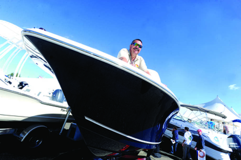 Jeffrey Slater parts manager with Norwest Marine on a 23 ft. Tidewater Sunday at the boat show in Norwalk. hour photo/Matthew Vinci