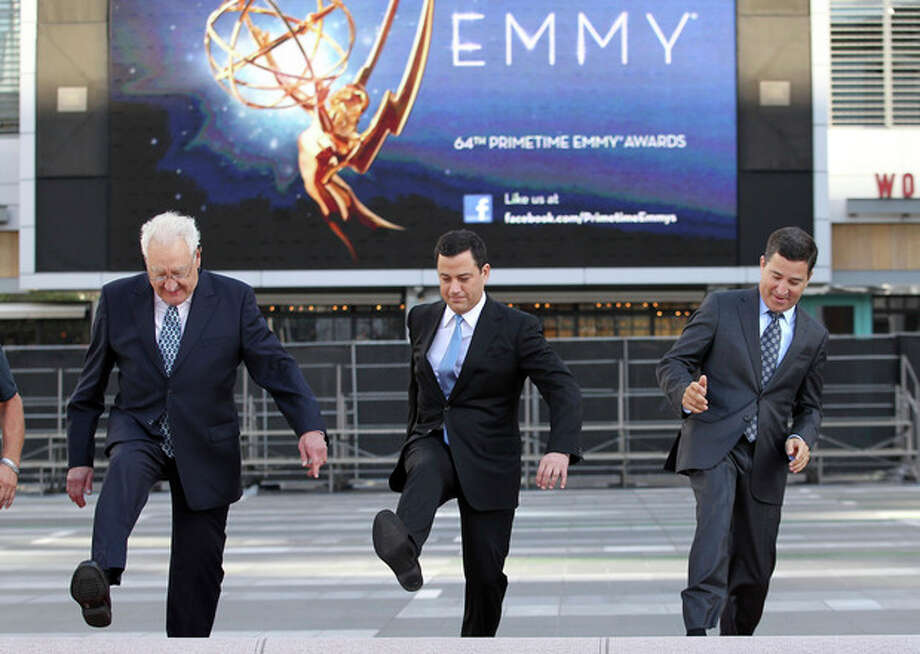 Don Mischer, executive producer of the 64th Primetime Emmy Awards, left, host Jimmy Kimmel, center, and Television Academy chairman and chief executive Bruce Rosenblum attend the Emmy Awards Red Carpet Rollout at the Nokia Theatre on Wednesday, Sept. 19, 2012, in Los Angeles. The Emmy Awards will be held Sunday, Sept 23. (Photo by Matt Sayles/Invision/AP) / Invision