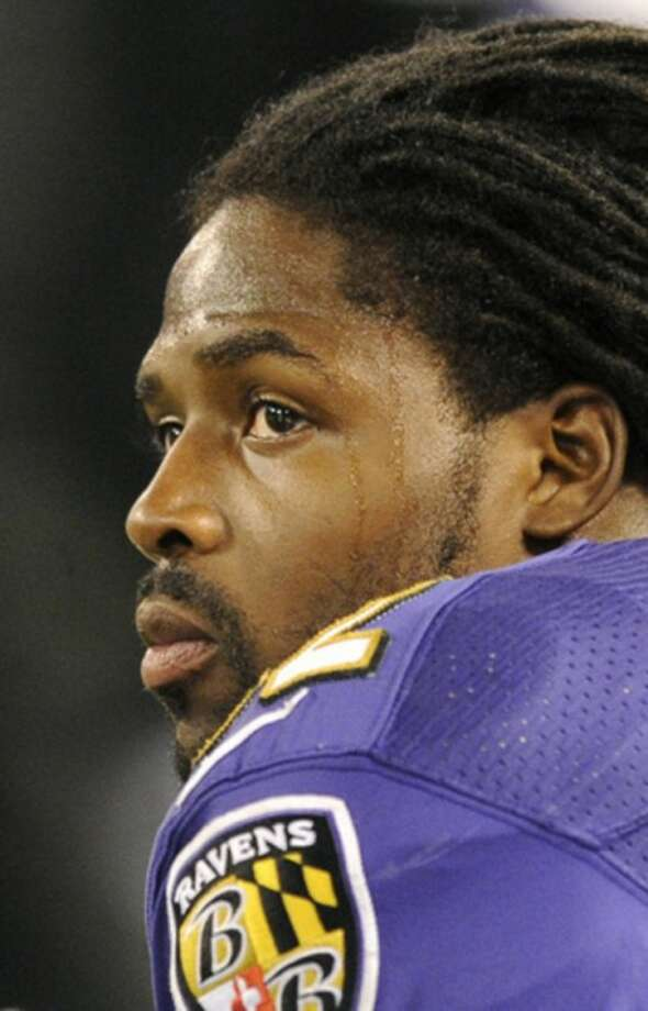 Baltimore Ravens wide receiver Torrey Smith looks on from the sideline in the first half of an NFL football game against the New England Patriots in Baltimore, Sunday, Sept. 23, 2012. Smith's younger brother, Tevin Chris Jones, 19, was killed late Saturday in a motorcycle accident in northeast Virginia. (AP Photo/Nick Wass)