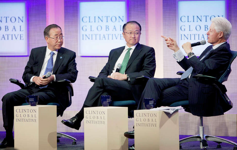 Ban Ki-Moon, left, Secretary-General of the United Nations, and Jim Yong Kim, center, President of the World Bank, listen to former U.S. President Bill Clinton during a panel discussion at the Clinton Global Initiative, Sunday, Sept. 23, 2012 in New York. (AP Photo/Mark Lennihan) / AP