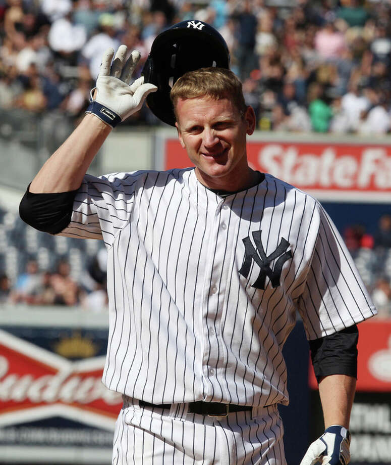 New York Yankees Lyle Overbay removes his helmet after flying out to deep center with two runners on base in the eighth inning of a baseball game against the Oakland Athletics in New York on Sunday, May 5, 2013. (AP Photo/Peter Morgan) / AP