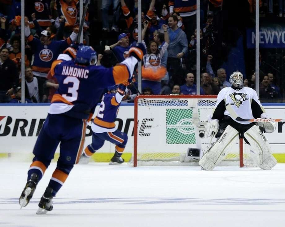 Pittsburgh Penguins goalie Marc-Andre Fleury, right, reacts after New York Islanders' John Tavares scored to tie the game during the third period of Game 3 of an NHL hockey Stanley Cup first-round playoff series on Sunday, May 5, 2013, in Uniondale, N.Y. (AP Photo/Seth Wenig) / AP