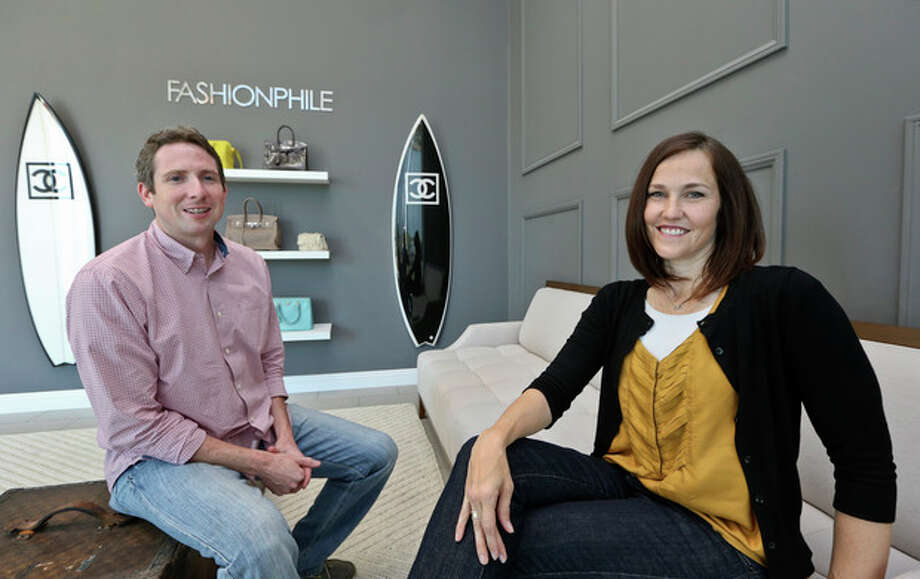 This photo taken May 2, 2013, shows Sarah Davis and Ben Hemmnger, co-owners of Fashionphile.com, posing in the lobby of their Carlsbad, Calif. office. The Internet company sells rare, vintage, and discontinued previous owned bags and is facing the complicated task of dealing with new state regulations on Internet sale taxes. (AP photo/Lenny Ignelzi) / AP