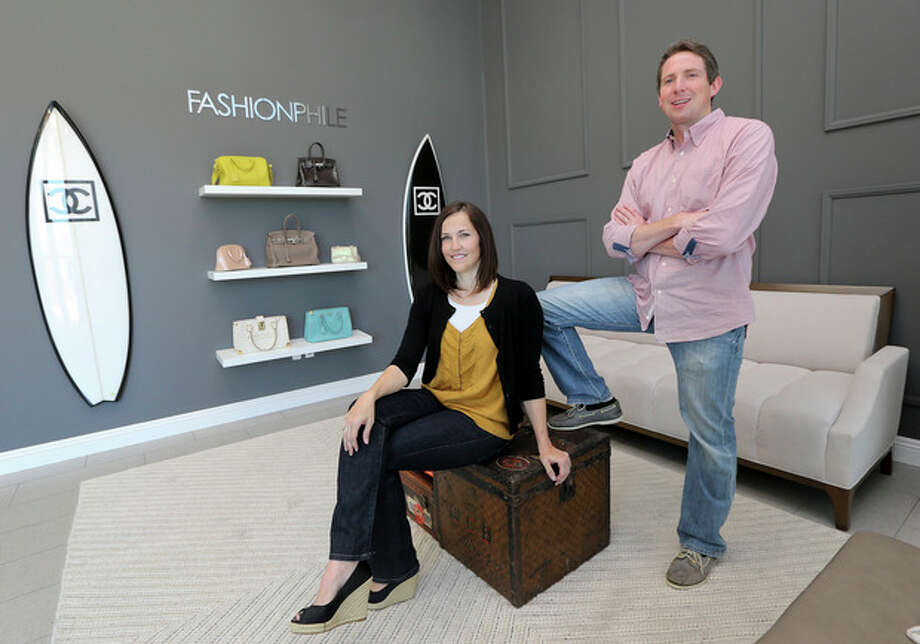 This photo taken May 2, 2013, shows Sarah Davis and Ben Hemmnger, co-owners of Fashionphile.com posing in the lobby of their Carlsbad, Calif. office. The internet company sells rare, vintage, and discontinued previous owned bags and is facing the complicated task of dealing with new state regulations on Internet sale taxes. (AP photo/Lenny Ignelzi) / AP