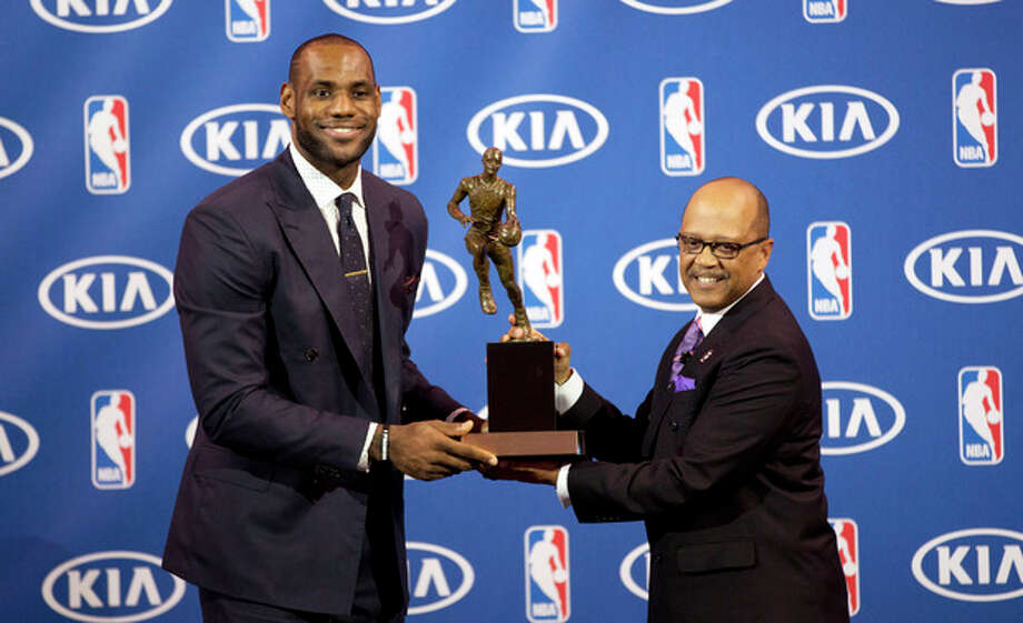 Miami Heat's LeBron James, left, and Kia Motors' Percy Vaughn pose for photos during an NBA basketball news conference, Sunday, May, 5, 2013, in Miami. James was formally announced as having won his fourth Most Valuable Player award Sunday. (AP Photo/J Pat Carter) / AP