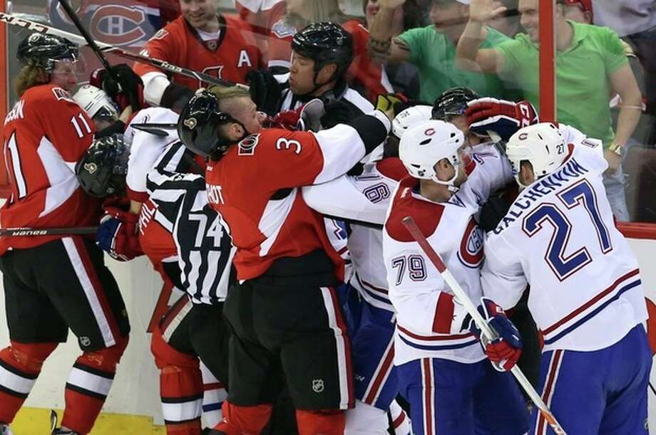 Montreal Canadiens players and Ottawa Senators players fight during the first period of Game 3 of their first-round NHL hockey Stanley Cup playoff series, Sunday, May 5, 2013, in Ottawa, Ontario. (AP Photo/The Canadian Press, Fred Chartrand) / The Canadian Press