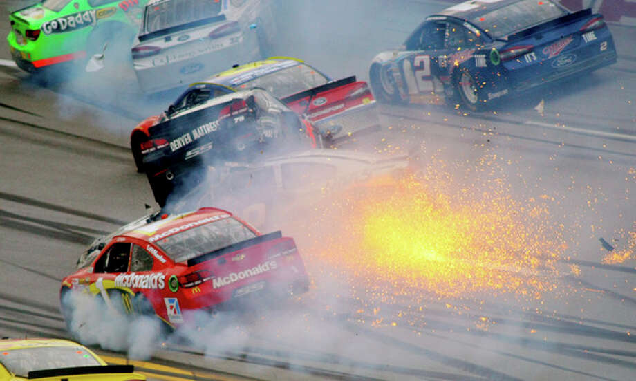 Drivers including Jamie McMurray (1) and Kurt Busch (78), atop Ryan Newman (39), collide as Brad Keselowski drives through the wreck in Turn 3 during the NASCAR Sprint Cup Series Aaron's 499 auto race at Talladega Superspeedway in Talladega, Ala., Sunday, May 5, 2013. (AP Photo/Greg McWilliams) / FR150231 AP