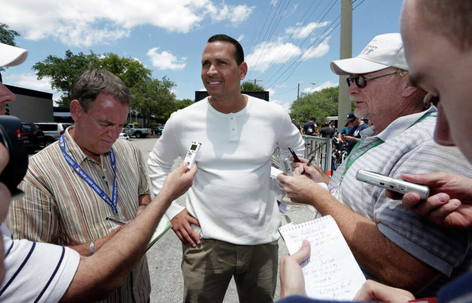 New York Yankees third baseman Alex Rodriguez talks to the media after reporting to the Yankees' Minor League complex for rehabilitation Monday, May 6, 2013, in Tampa, Fla. Rodriguez is rehabbing from hip surgery. (AP Photo/Chris O'Meara) / AP