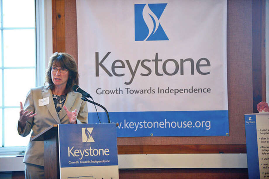 Valerie Williams of Keystone House talks to candidates for state representative and senate at the forum on mental health issues. / (C)2012, The Hour Newspapers, all rights reserved