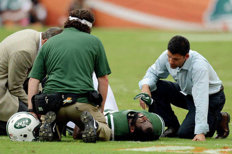 FILE - In this Sunday, Sept. 23, 2012 file photo, New York Jets trainers attend to cornerback Darrelle Revis (24) during the second half of an NFL football game against the Miami Dolphins, in Miami. Revis has a torn anterior cruciate ligament in his left knee that will require surgery, likely meaning he'll miss the rest of the season, the team announced Monday, Sept. 24. (AP Photo/Rhona Wise, File) / FR168022 AP
