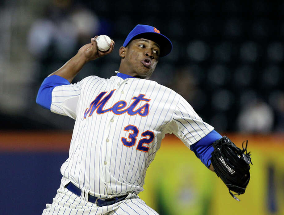 New York Mets starting pitcher Jenry Mejia delivers in the first inning against the Pittsburgh Pirates during their baseball game at Citi Field in New York, Monday, Sept. 24, 2012. (AP Photo/Kathy Willens) / AP