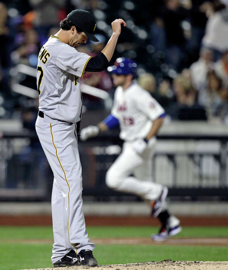 Pittsburgh Pirates relief pitcher Jeff Karstens reacts after allowing a three-run home run to New York Mets' Ike Davis during the fifth inning of a baseball game in New York, Monday, Sept. 24, 2012. (AP Photo/Kathy Willens) / AP