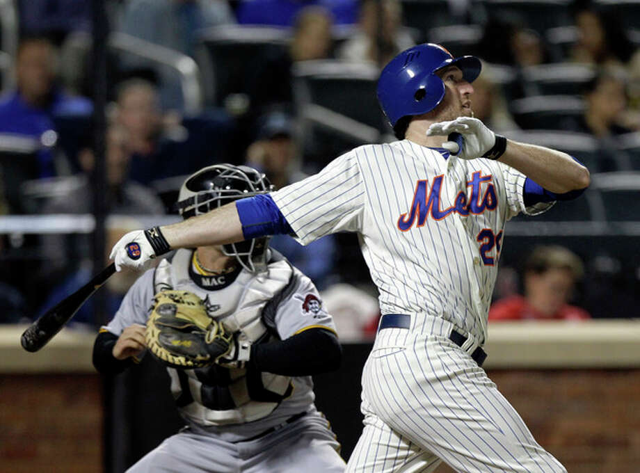 New York Mets' Ike Davis watches his two-run home run off Pittsburgh Pirates relief pitcher Kyle McPherson during the fourth inning of a baseball game in New York, Monday, Sept. 24, 2012. (AP Photo/Kathy Willens) / AP