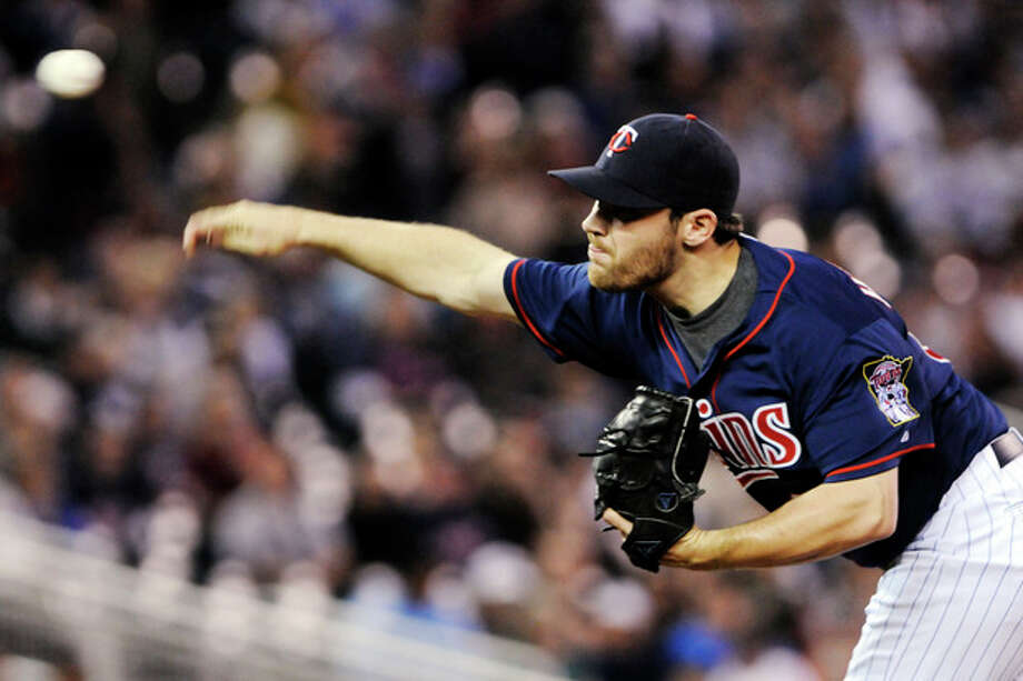 Minnesota Twins pitcher Liam Hendriks throws against the New York Yankees in the first inning of a baseball game, Monday, Sept. 24, 2012, in Minneapolis. (AP Photo/Jim Mone) / AP