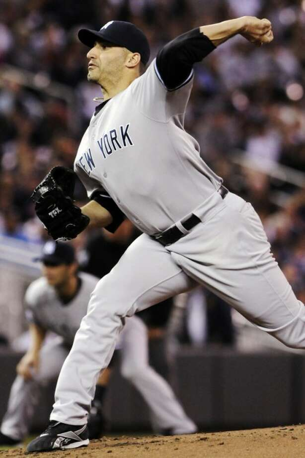 New York Yankees pitcher Andy Pettitte throws against the Minnesota Twins in the first inning of a baseball game, Monday, Sept. 24, 2012, in Minneapolis. (AP Photo/Jim Mone)