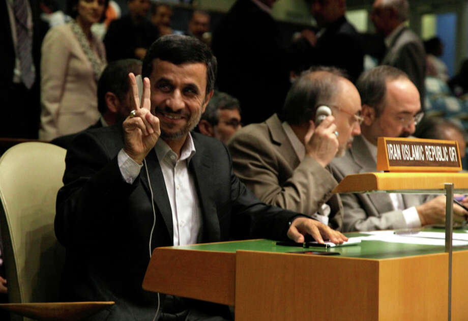 Iran's President Mahmoud Ahmadinejad gestures as he attends the high level meeting on rule of law in the United Nations General Assembly, at U.N. headquarters Monday, Sept. 24, 2012. (AP Photo/Richard Drew) / AP