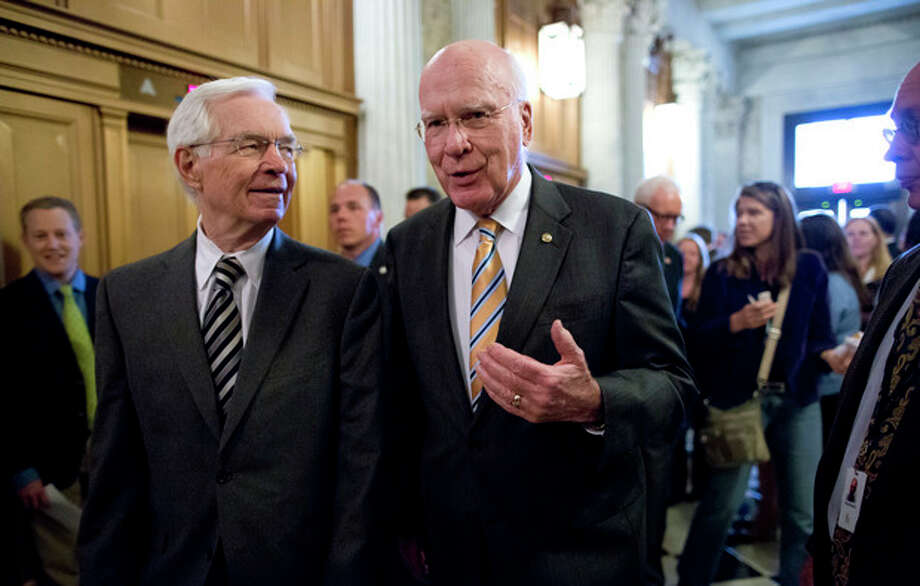 Sen. Patrick Leahy, D-Vt., president pro tempore of the Senate, right, and Sen. Thad Cochran, R-Miss., left, walk to the floor of the Senate during a vote on legislation to collect sales tax on Internet purchases, on Capitol Hill in Washington, Monday, May 6, 2013. (AP Photo/J. Scott Applewhite) / AP
