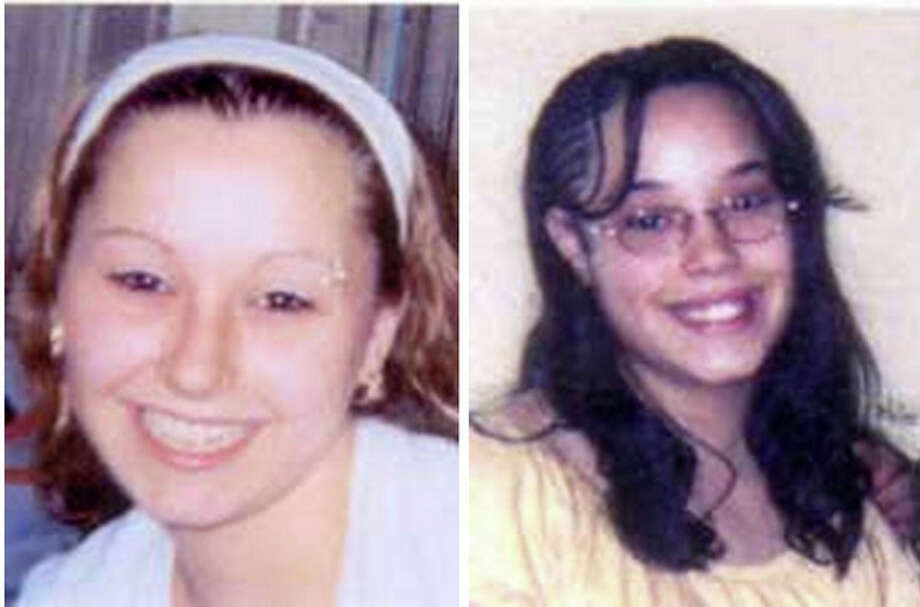 "These undated handout photos provided by the FBI show Amanda Berry, left, and Georgina ""Gina"" Dejesus. Cleveland Police Chief Michael McGrath said he thinks Berry, DeJesus and Michelle Knight were tied up at the house and held there since they were in their teens or early 20s. Berry and the two other women who went missing a decade ago were found on Monday, May 6, 2013 elating family members and friends who'd longed to see them again. (AP Photo/FBI) / FBI"