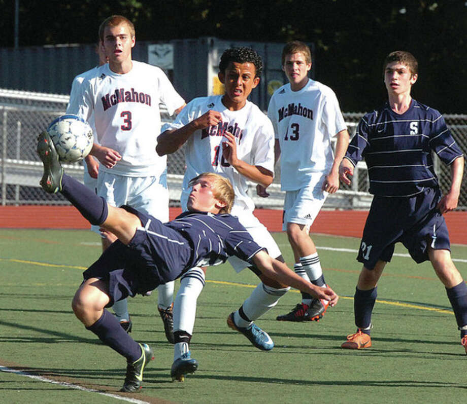 Hour photo/Alex von KleydorffJordan McNair of Staples goes all out on a bicycle kick during Tuesday's game against Brien McMahon. McNair's spectacular effort went for naught. The visiting Wreckers, however, cashed in on a 1-0 victory over McMahon. / 2012 The Hour Newspapers