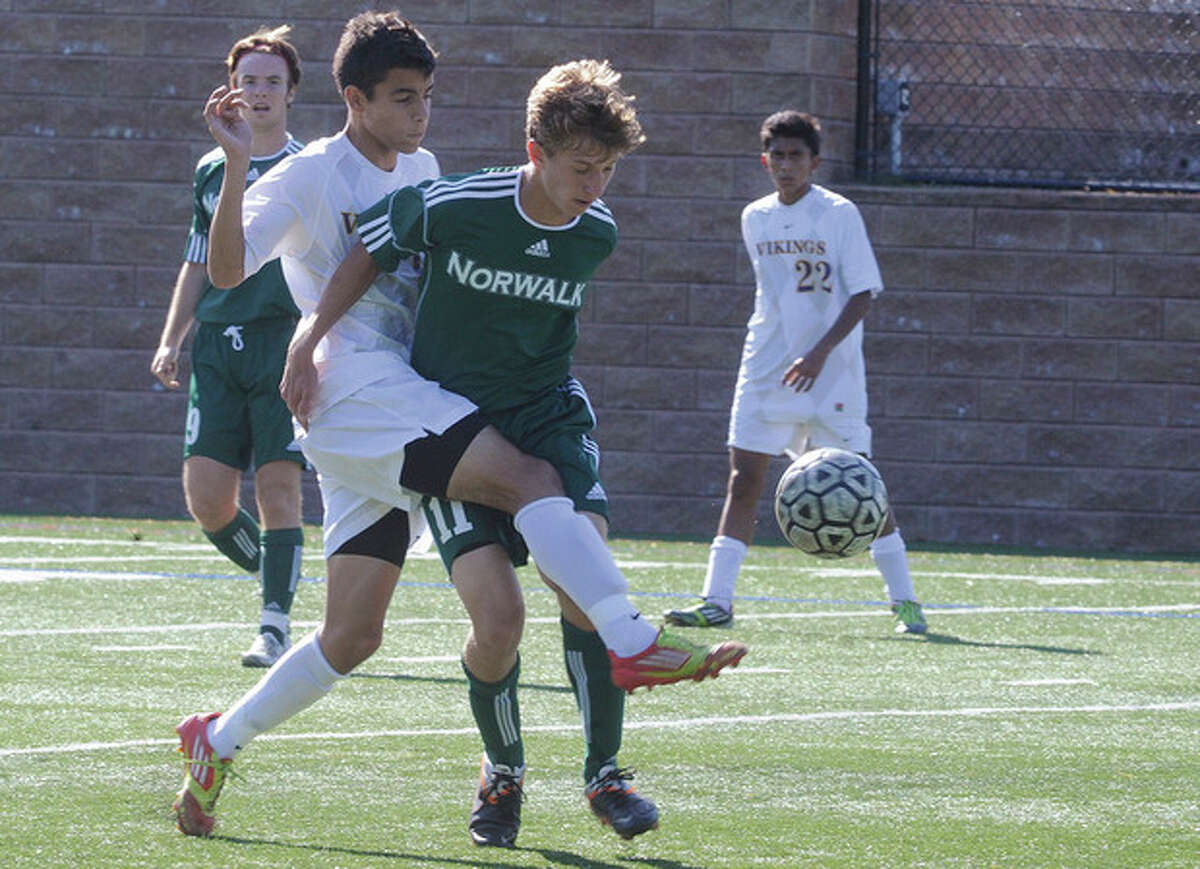 Hour photo/Matthew Vinci Westhill's Filosmar Cordeiro, left, battles for the ball against Norwalk's Michal Nowicki during Tuesday's game in Stamford. The visiting Bears collected a 2-0 victory.