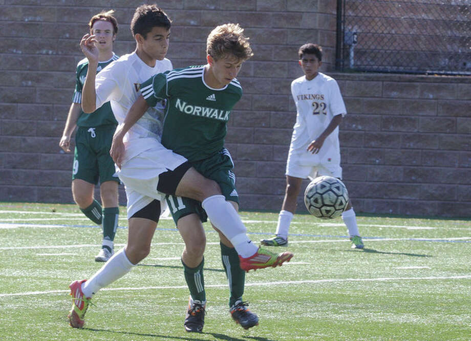 Hour photo/Matthew VinciWesthill's Filosmar Cordeiro, left, battles for the ball against Norwalk's Michal Nowicki during Tuesday's game in Stamford. The visiting Bears collected a 2-0 victory. / (C)2011 {your name}, all rights reserved