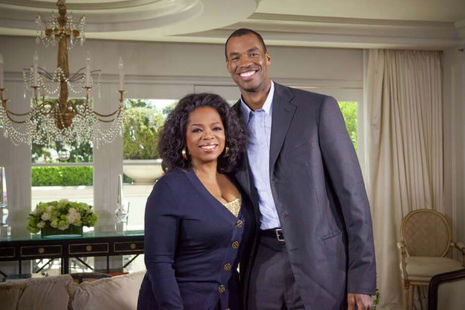 "This May 1, 2013 photo released by OWN shows host Oprah Winfrey posing with NBA basketball player Jason Collins during an interview for ""Oprah's Next Chapter,"" in Beverly Hills, Calif. The interview aired Sunday. Officials at three publishing houses said Monday, May 6, that they had been contacted about a planned memoir by Collins, the first active player in any of four major U.S. professional sports leagues to come out as gay. (AP Photo/OWN, Chuck Hodes) / OWN"