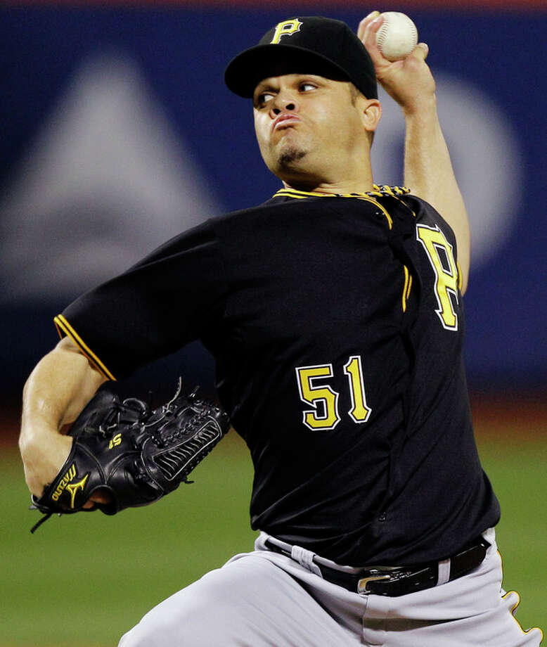 Pittsburgh Pirates starting pitcher Wandy Rodriguez delivers against the New York Mets in the first inning of their baseball game at Citi Field in New York, Tuesday, Sept. 25, 2012. (AP Photo/Kathy Willens) / AP
