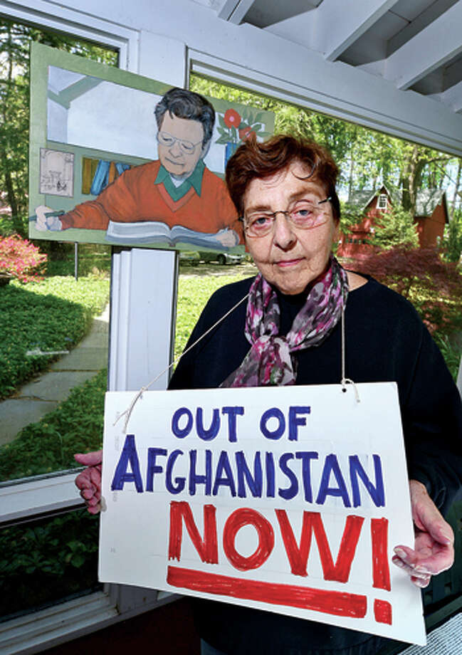 Westport resident Estelle Margolis is a longtime peace protester and has been protesting the war in Afghanistan for 12 years. Hour photo / Erik Trautmann / (C)2013, The Hour Newspapers, all rights reserved