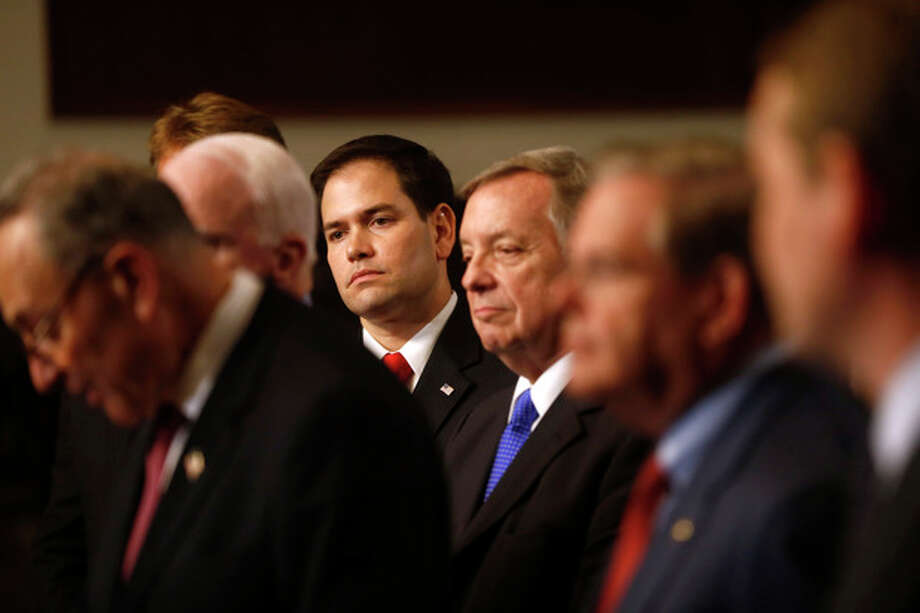 FILE - In this April 18, 2013 file photo, Sen. Marco Rubio, R-Fla., center, and others Senators, participate in a news conference on immigration on Capitol Hill in Washington. From left are, Sen. Charles Schumer, D-N.Y., Sen. John McCain, R-Ariz., Sen. Jeff Flake, R-Ariz., Rubio, Senate Majority Whip Richard Durbin of Ill., and Sen. Robert Menendez, D-N.J. One of the legislation's authors, Sen. Marco Rubio, R-Fla., has already acknowledged that the bill will face a tough road to passage if the border security elements are not improved. (AP Photo/Charles Dharapak) / AP
