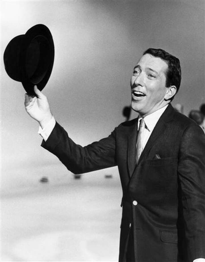 """FILE - In a May 12, 1961 file photo, Andy Williams performs a song on a television show. Emmy-winning TV host and """"Moon River"""" crooner Williams died Tuesday night, Sept, 25, 2012 at his home in Branson, Mo., following a year-long battle with bladder cancer. He was 84. (AP Photo, File) / AP"""